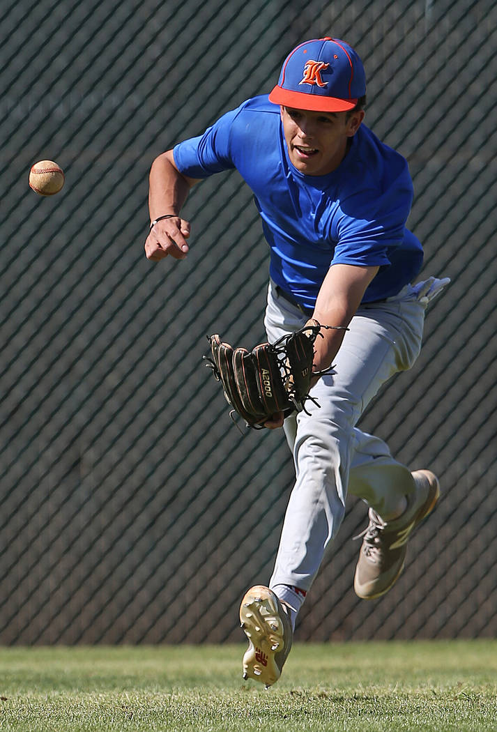 Bishop Gorman sophomore Carson Wells reaches for a ball during outfield drills at practice on Monday, April 16, 2018, at Bishop Gorman High School, in Las Vegas. The sophomore center fielder is al ...