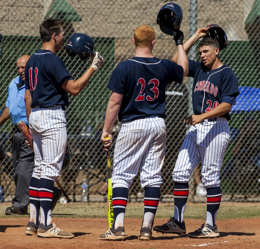 Coronado players celebrate after Cristian Herrera, right, hit a home run in the fourth inning at Rancho High School in Las Vegas on Saturday, April 21, 2018. Rancho won 5-1. Patrick Connolly Las ...