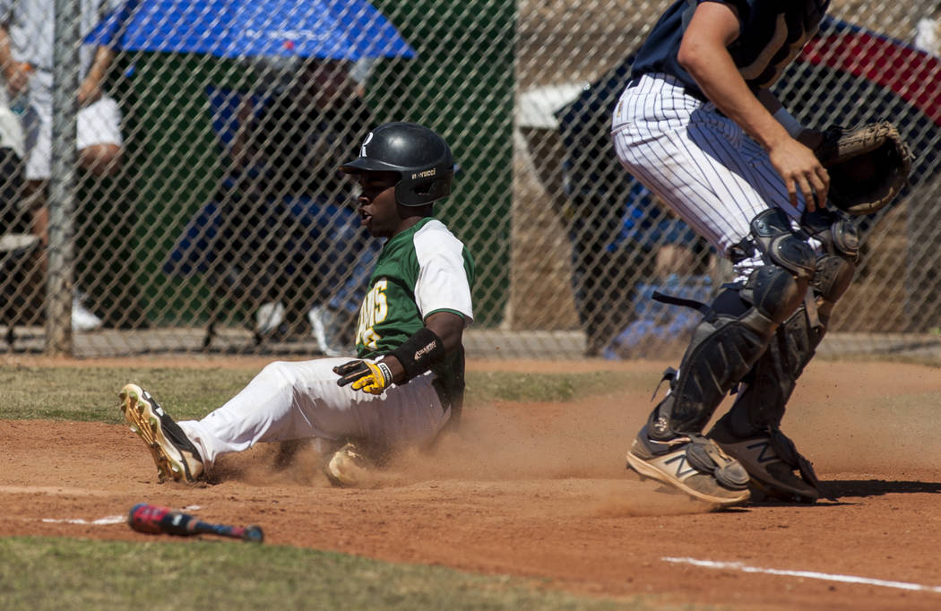 Rancho's Donovan Gladney slides in safe at home during the fourth inning while playing against Coronado at Rancho High School in Las Vegas on Saturday, April 21, 2018. Rancho won 5-1. Patrick Con ...