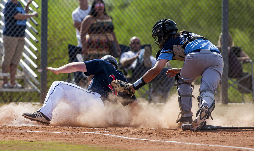 Coronado's Boston Mabeus slides in safe at home while Foothill catcher Eric Vaccaro tries to tag him out in the second inning at Coronado High School on Tuesday, April 24, 2018. Coronado won 12-2. ...