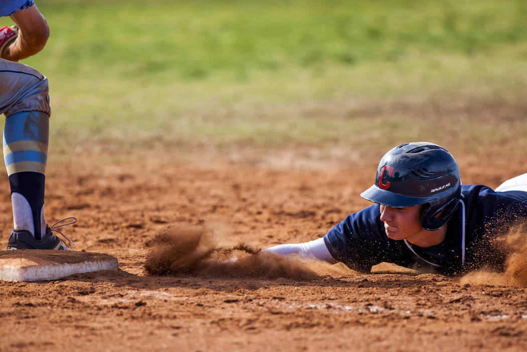Coronado's Taylor Darden slides in safe at first while Foothill's Andrew Hauck stands by in the third inning at Coronado High School on Tuesday, April 24, 2018. Coronado won 12-2. Patrick Connoll ...
