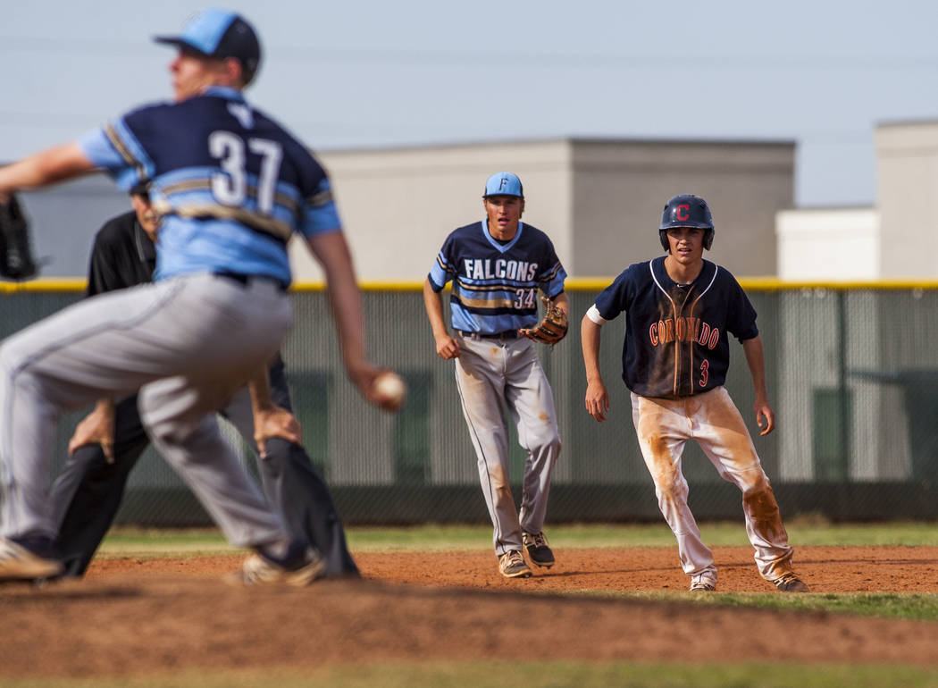Coronado's Cade Printy leads off of second base while Foothill second baseman Kelton Lachelt watches and Tyler Kara pitches in the fourth inning at Coronado High School on Tuesday, April 24, 2018. ...