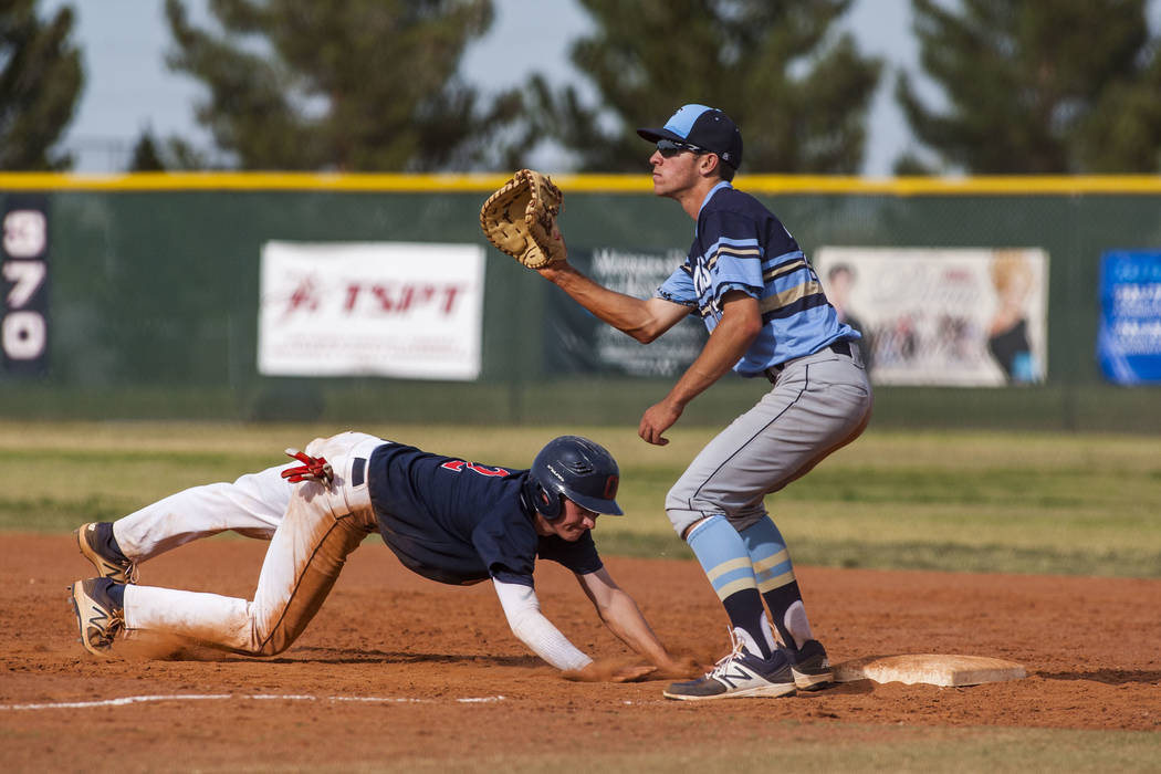 Coronado's Taylor Darden slides in safe at first while Foothill's Andrew Hauck looks to make a play in the fourth inning at Coronado High School on Tuesday, April 24, 2018. Coronado won 12-2. Pat ...