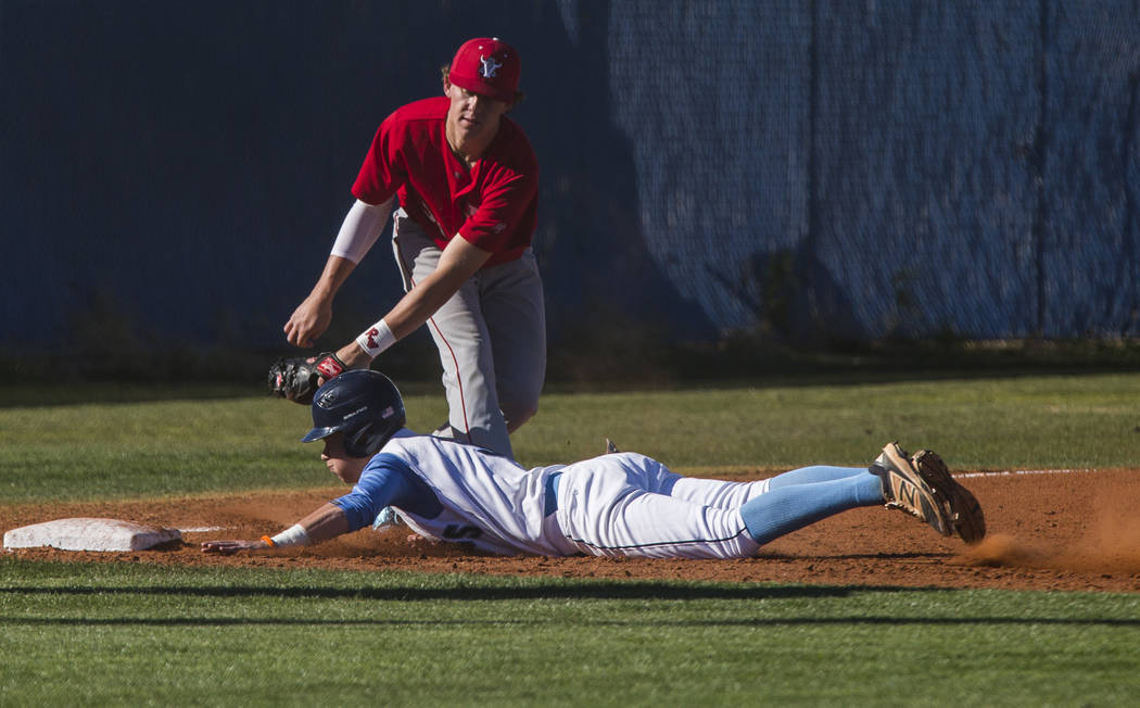 Arbor View infielder Austin Pfeifer tags Centennial's Payton Moody out at third base during the third inning at Centennial Hills High School in Las Vegas on Friday, March 23, 2018. Centennial won ...