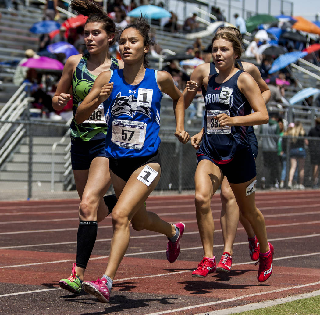 Basic junior Raquel Chavez, center, runs in the 1,600-meter run, finishing first with a time of 5:26.16 at Basic High School on Saturday, May 5, 2018. Patrick Connolly Las Vegas Review-Journal @P ...