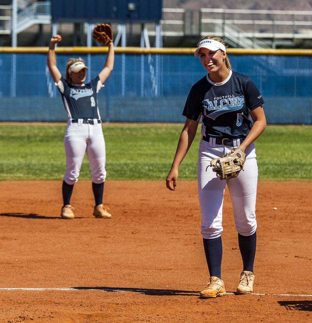 Foothill sophomore pitcher Leah Becker laughs as her sister Kylie Becker, a senior shortstop player, raises her arms during practice at Foothill High School on Friday, May 5, 2018. Patrick Connol ...