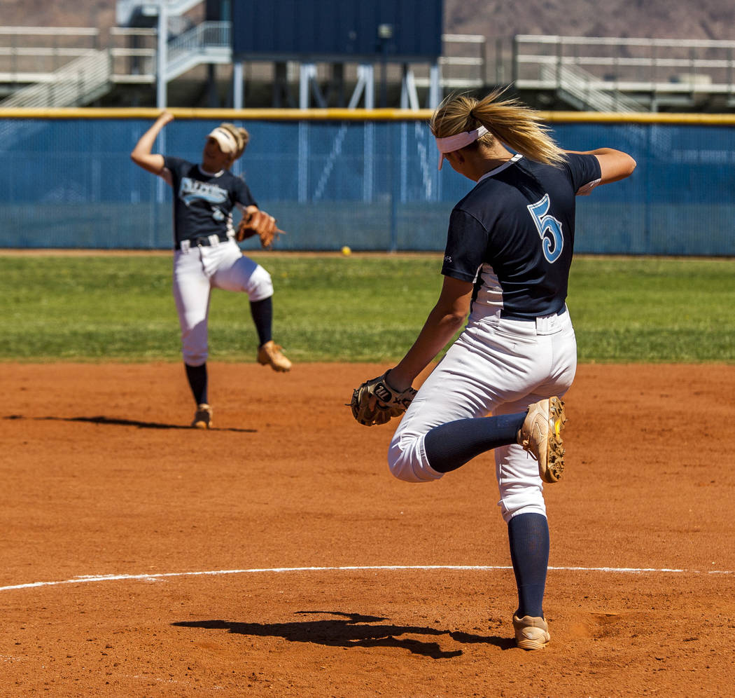 """Foothill sophomore pitcher Leah Becker and her sister Kylie Becker, a senior shortstop player, share a """"strikeout"""" dance during practice at Foothill High School on Friday, May 5, 2018. ..."""