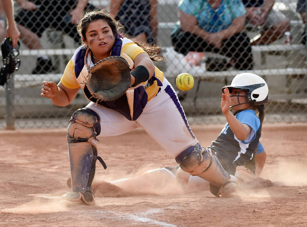 Durango catcher Alexis Geraldo looks to catch the ball as Durango's Samantha Lawrence slides safely home during a high school softball game at Durango High School Tuesday, May 8, 2018, in Las Vega ...
