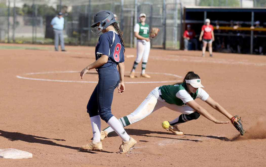 Green Valley Cristina De Los Angeles (18) bobbles the throw from home as Coronado baserunner Madi Stephens (8) goes back to third base in the second inning of a softball game against Coronado at C ...