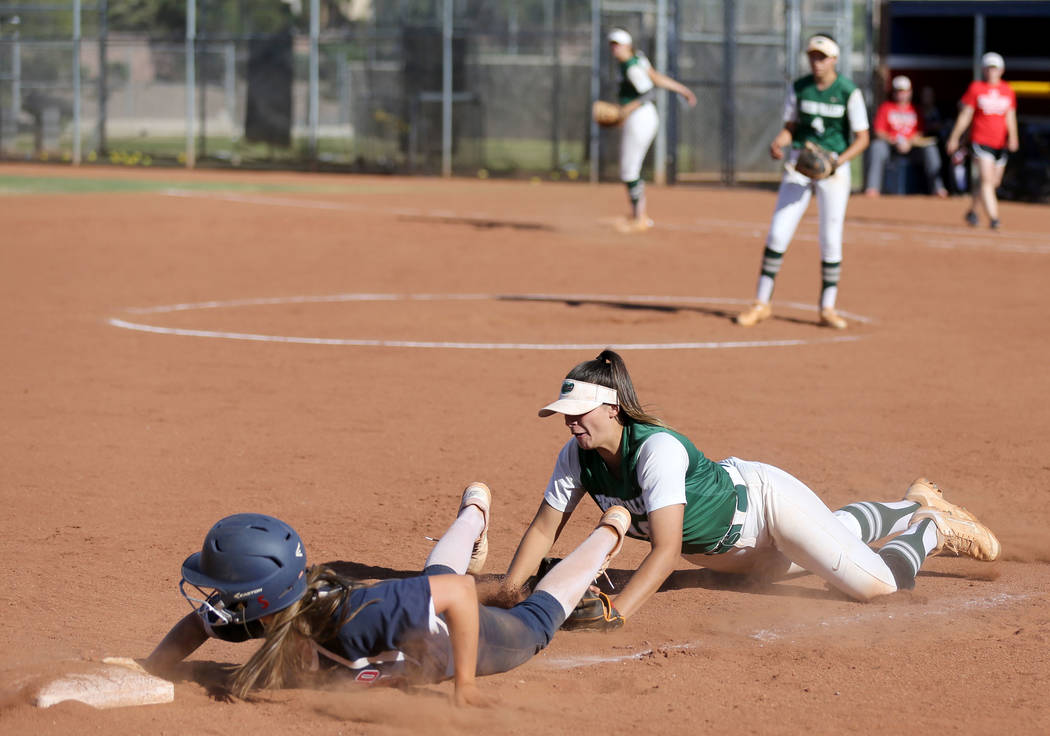 Coronado baserunner Tatum Spangler (5) dives safely back to third past the tag of Green Valley infielder Cristina De Los Angeles (18) in the third inning of a softball game against Coronado at Cor ...