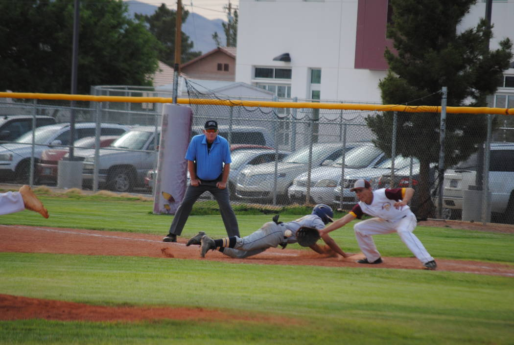 Boulder City's Travis Hungerford dives safely back to first on Thursday, May 10, 2018. (Courtesy Charlotte Uyeno)