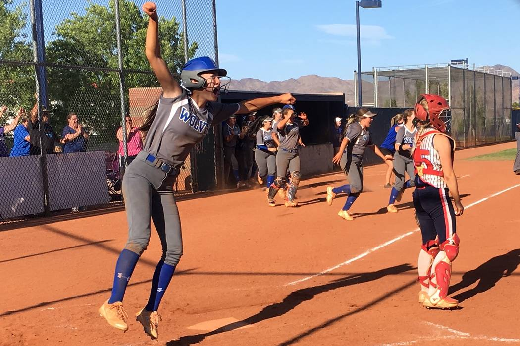 Basic's softball team celebrates advancing to the Sunrise Region title game after beating Liberty, 4-3 at Foothill High School in Henderson, Nev. on May 11, 2018. Justin Emerson/Las Vegas Review-J ...