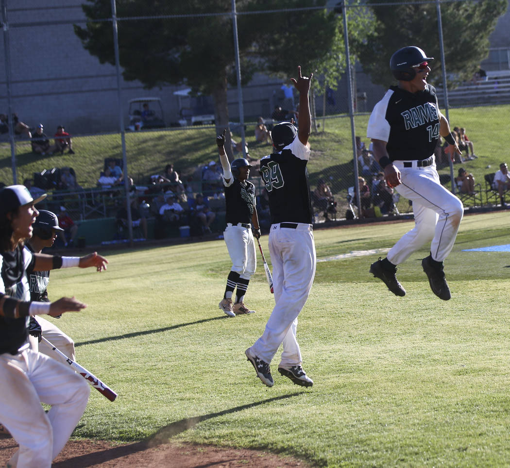 Rancho players react to a grand slam hit by Rancho's Anthony Guzman, not pictured, during the Sunset Region semifinal baseball game against Coronado at Green Valley High School in Henderson on Fri ...