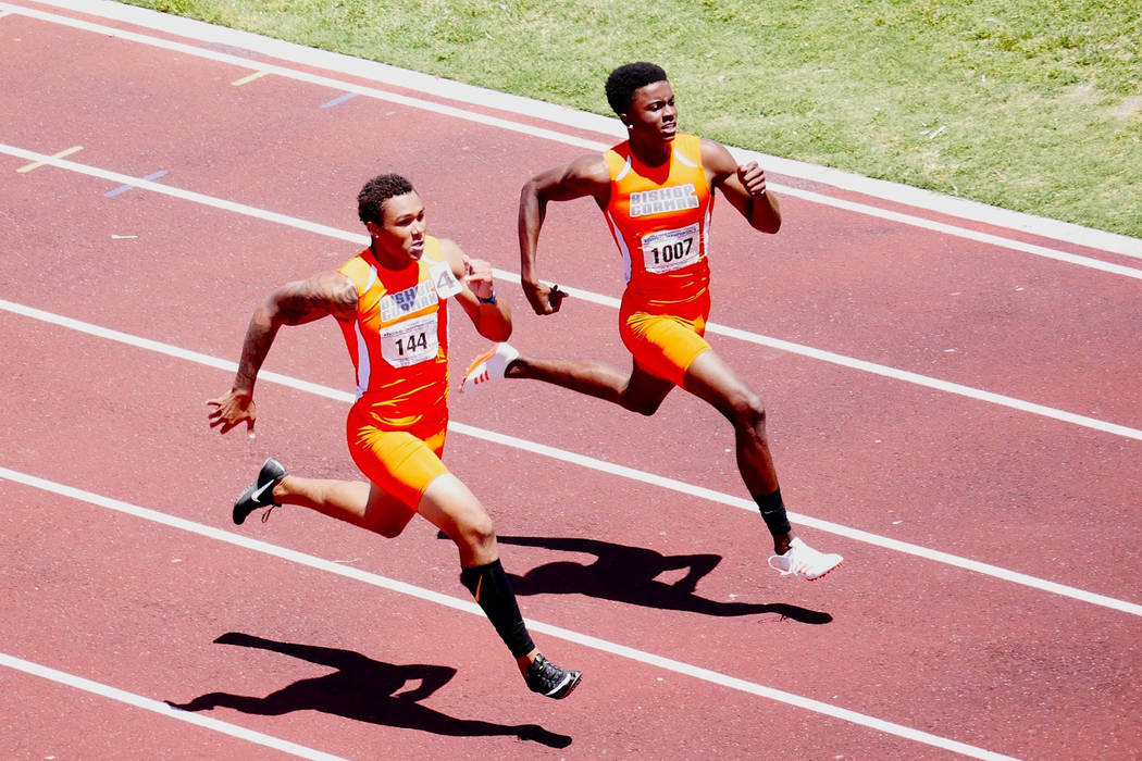 Bishop Gorman's Jalen Nailor and Kyu Kelly compete in the 200-meter dash at the Sunset Region track meet on Saturday at Basic High School. (Courtesy Brian Davidson)