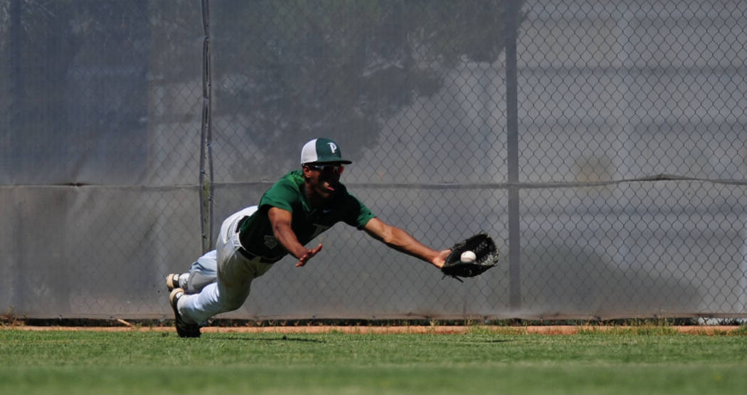 Palo Verde outfielder Karsonne Winters makes a diving catch against Centennial in the first inning of the 2018 NIAA Class 4A Sunset Region Championship game at Shadow Ridge High School in North La ...