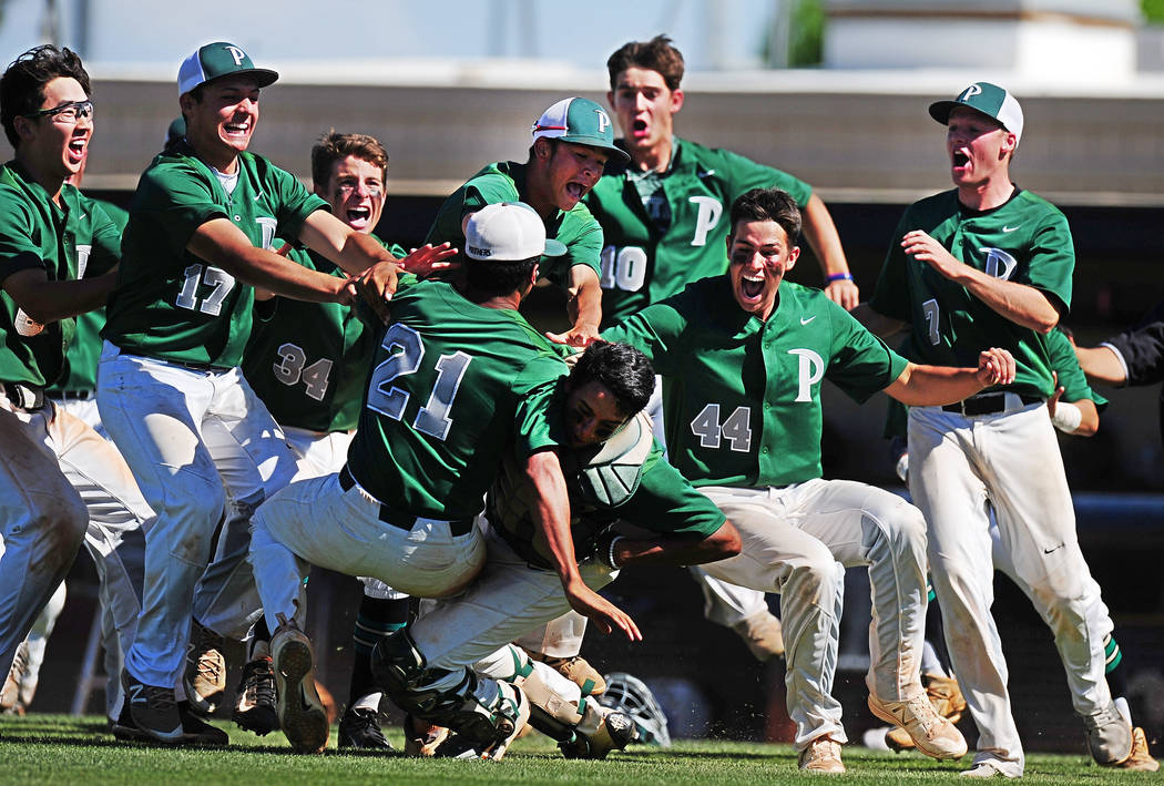 Palo Verde players celebrate winning the 2018 NIAA Class 4A Sunset Region Championship over Centennial at Shadow Ridge High School in North Las Vegas, Saturday, May 12, 2018. Palo Verde defeated ...