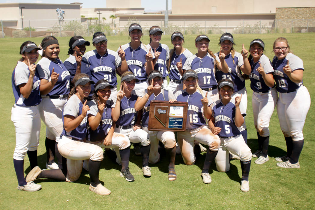 The Shadow Ridge Girls Softball team poses with their trophy after defeating Palo Verde to clinch the 2018 NIAA Class 4A Sunset Region championship at Bishop Gorman High School on Saturday, May 12 ...