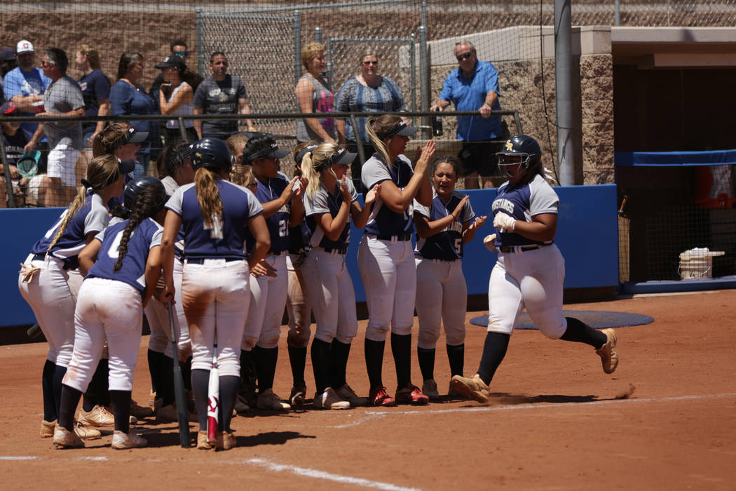 Shadow Ridge teammates greet Alyssa Stanley (22) at the plate after a home run during the 2018 NIAA Class 4A Sunset Region championship game against Palo Verde at Bishop Gorman High School on Satu ...