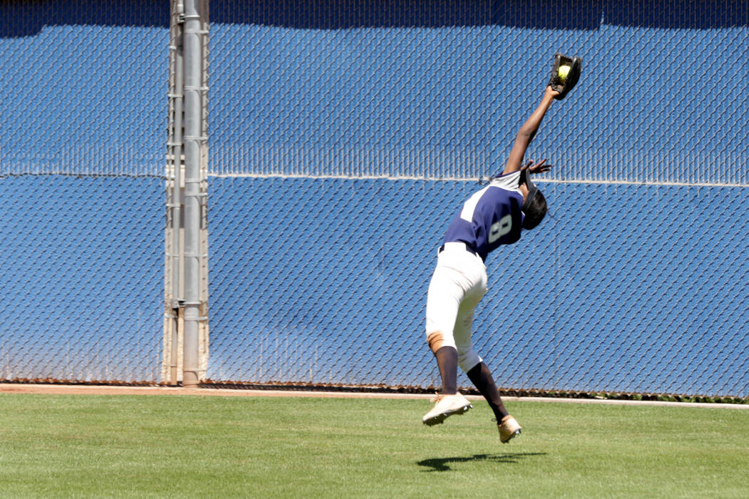 Shadow Ridge Jasmine Martin (8) snags a deep fly ball during the 2018 NIAA Class 4A Sunset Region championship at Bishop Gorman High School on Saturday, May 12, 2018. Michael Quine/Las Vegas Revie ...