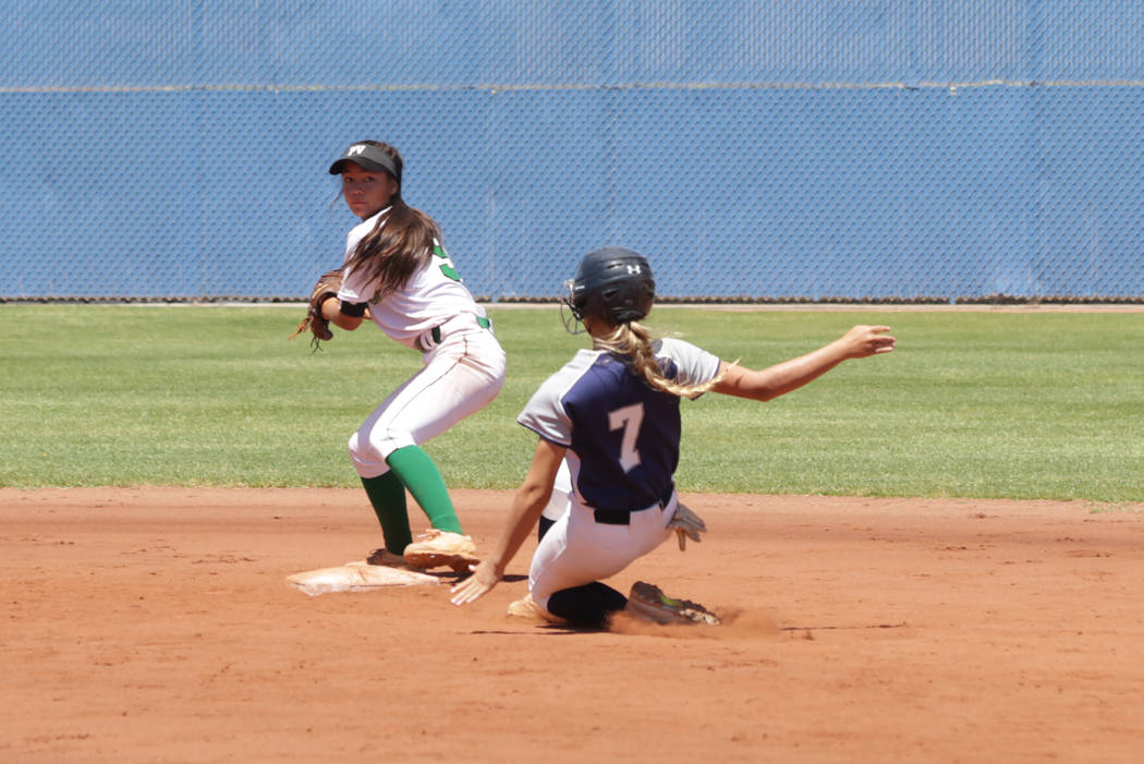 Palo Verdeճ Lauryn Barker (9) goes for a double play as as Shadow Ridgeճ (7) slides into second during the 2018 NIAA Class 4A Sunset Region championship at Bishop Gorman High School on ...