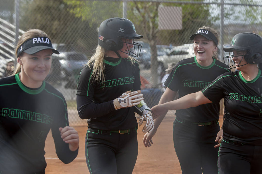Palo Verde's Lauryn Barker, second from left, celebrates with teammates after scoring a run during the third inning while playing against Shadow Ridge at Shadow Ridge High School in Las Vegas on T ...