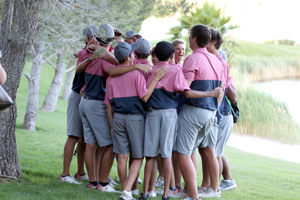 Members of the Coronado High School golf team huddle after winning the team Class 4A Nevada state championship at Reflection Bay Golf Club in Henderson Tuesday, May 15, 2018. K.M. Cannon Las Vegas ...