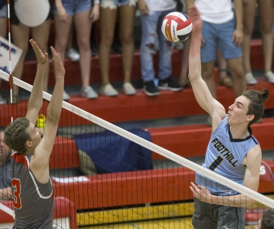 Foothills senior Dylan Meuller (1) makes a kill over Arbor View senior Jake Reid (3) during the class 4A state boys volleyball semifinal on Tuesday, May 15, 2018, at Arbor View High School, in Las ...