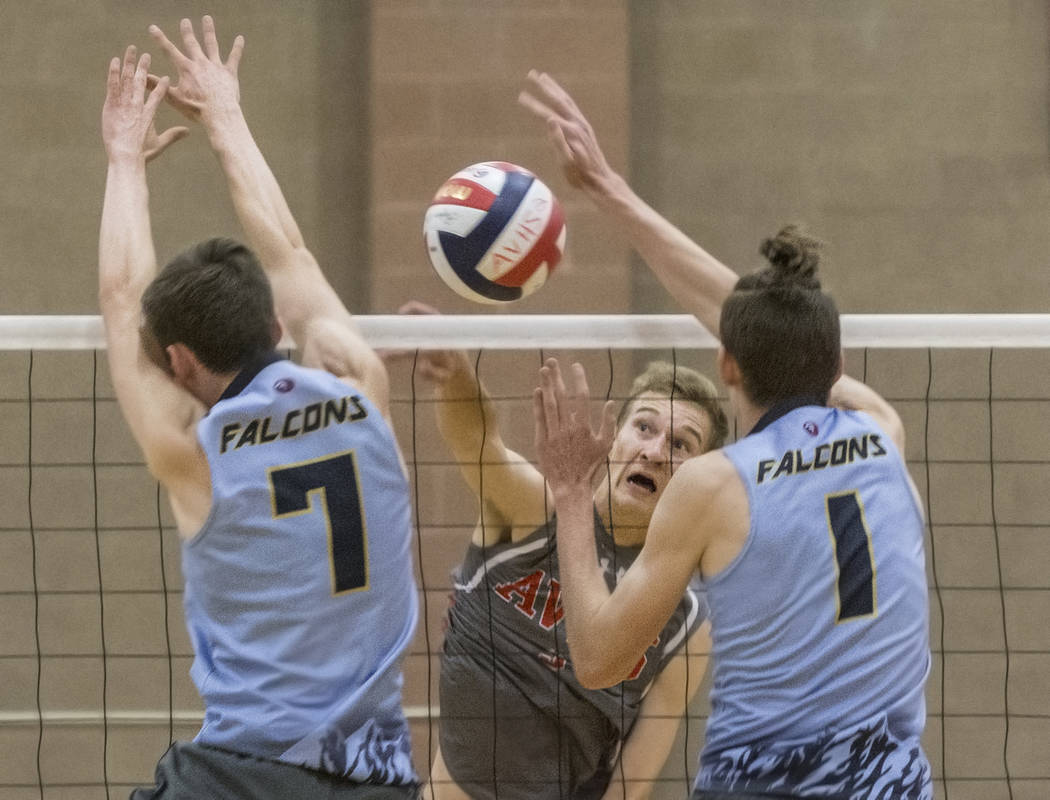 Arbor View senior Jake Reid (3) makes a kill past Foothills' Dylan Meuller (1) and Caden Thomas (7) during the class 4A state boys volleyball semifinal on Tuesday, May 15, 2018, at Arbor View High ...