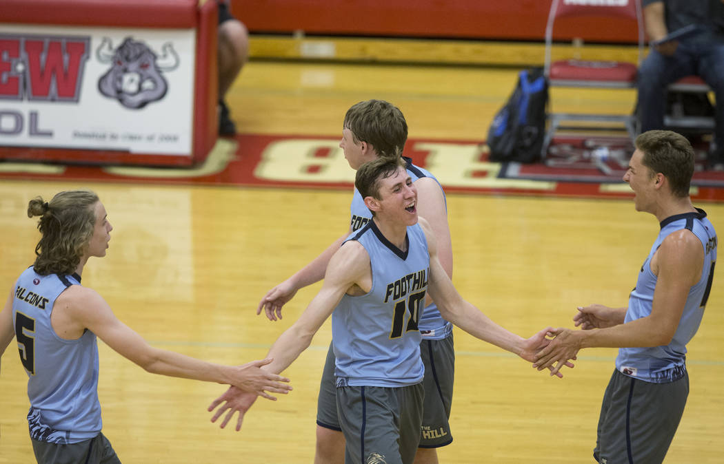 Foothills junior Caleb Stearman (10) celebrates with teammates after scoring a point during the class 4A state boys volleyball semifinal on Tuesday, May 15, 2018, at Arbor View High School, in Las ...