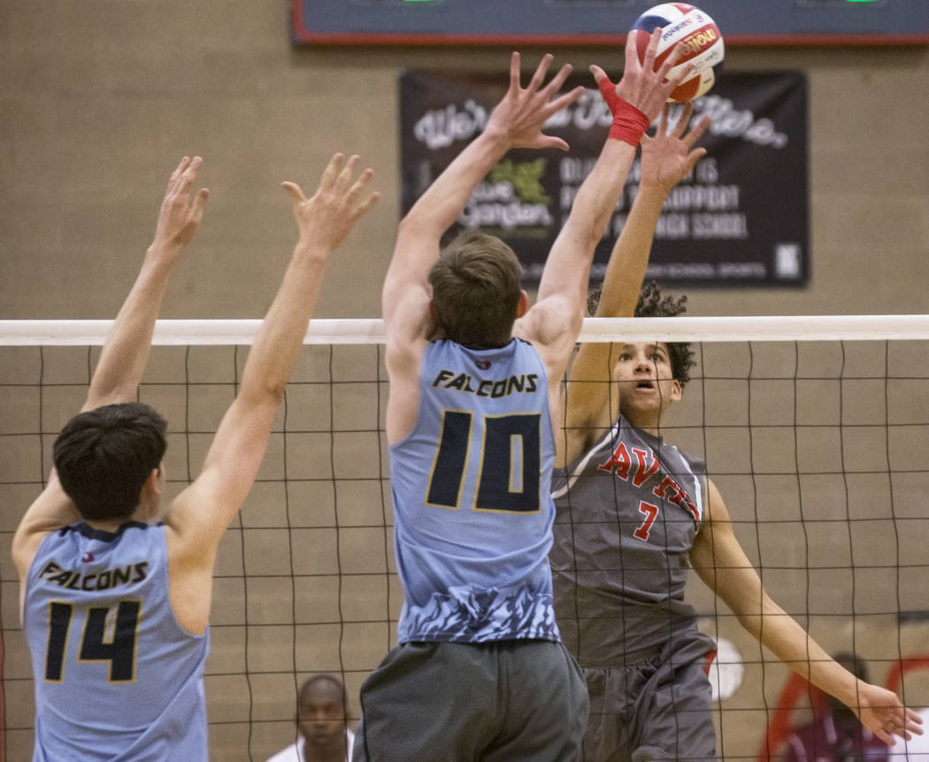 Arbor View senior Keandre Suares (7) makes a kill past Foothill's Caleb Stearman (10) and Truss Erb (14) during the class 4A state boys volleyball semifinal on Tuesday, May 15, 2018, at Arbor View ...