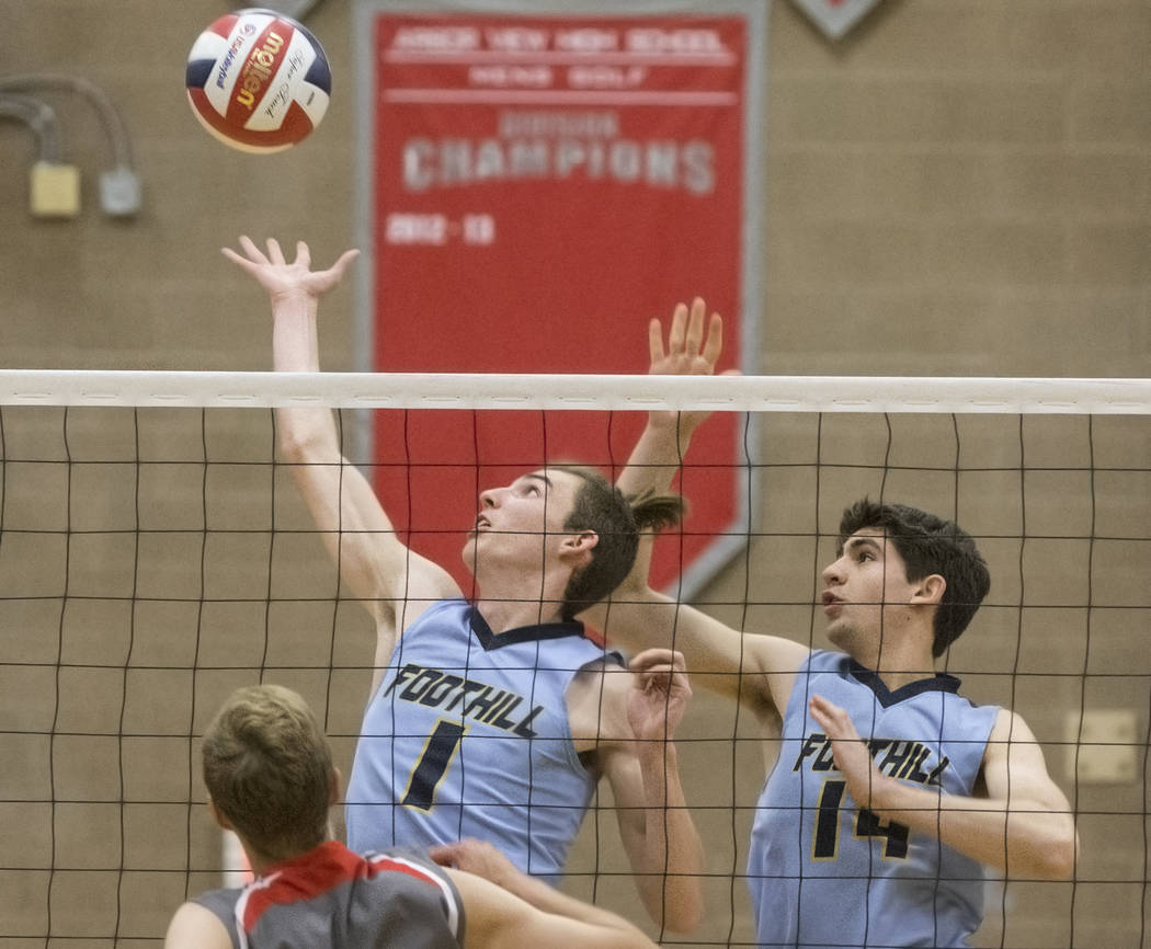 Foothills Dylan Meuller (1) and Truss Erb (14) try to block a kill during the class 4A state boys volleyball semifinal on Tuesday, May 15, 2018, at Arbor View High School, in Las Vegas. Foothills ...