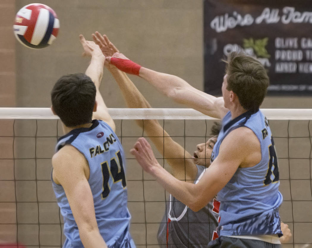 Arbor View senior Keandre Suares (7) makes a kill past Foothill's Truss Erb (14) and Tanner Lester (4) during the class 4A state boys volleyball semifinal on Tuesday, May 15, 2018, at Arbor View H ...