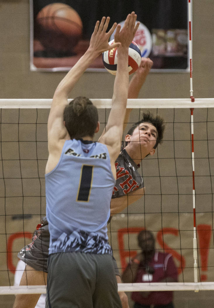 Arbor View junior Gideon Belnap (5) makes a kill past Foothills senior Dylan Meuller (1) during the class 4A state boys volleyball semifinal on Tuesday, May 15, 2018, at Arbor View High School, in ...