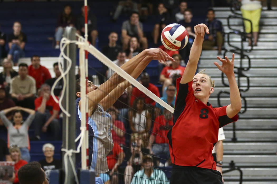Centennial's Teon Taylor (13) defends against an attack from Las Vegas' Shaun Kampshoff (8) during the Class 4A boys state semifinal volleyball game at Coronado High School in Henderson on Tuesday ...