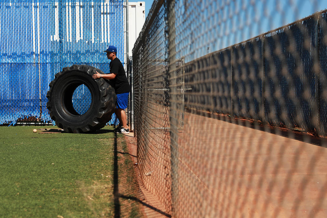 Basic's C.J. Dornak rolls out a tire for ab workouts during baseball practice at Basic High School in Henderson, Nevada on Tuesday, May 15, 2018. Andrea Cornejo Las Vegas Review-Journal @dreacornejo