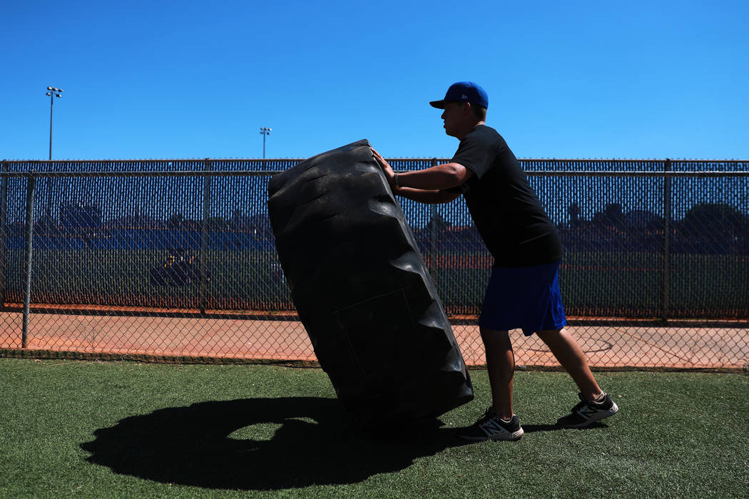 Basic's C.J. Dornak flips a tire as part of an ab workout during baseball practice at Basic High School in Henderson, Nevada on Tuesday, May 15, 2018. Andrea Cornejo Las Vegas Review-Journal @drea ...