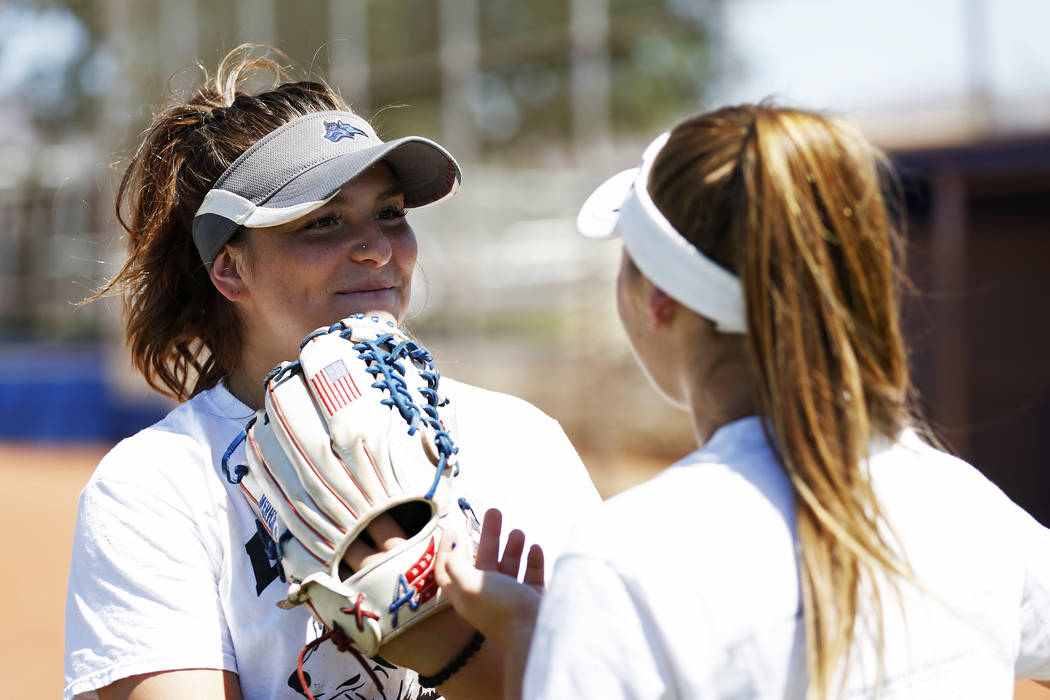 Basic's Angela Santillanes, left, talks to a teammate during softball practice at Basic High School in Henderson, Nevada on Tuesday, May 15, 2018. Andrea Cornejo Las Vegas Review-Journal @dreacornejo