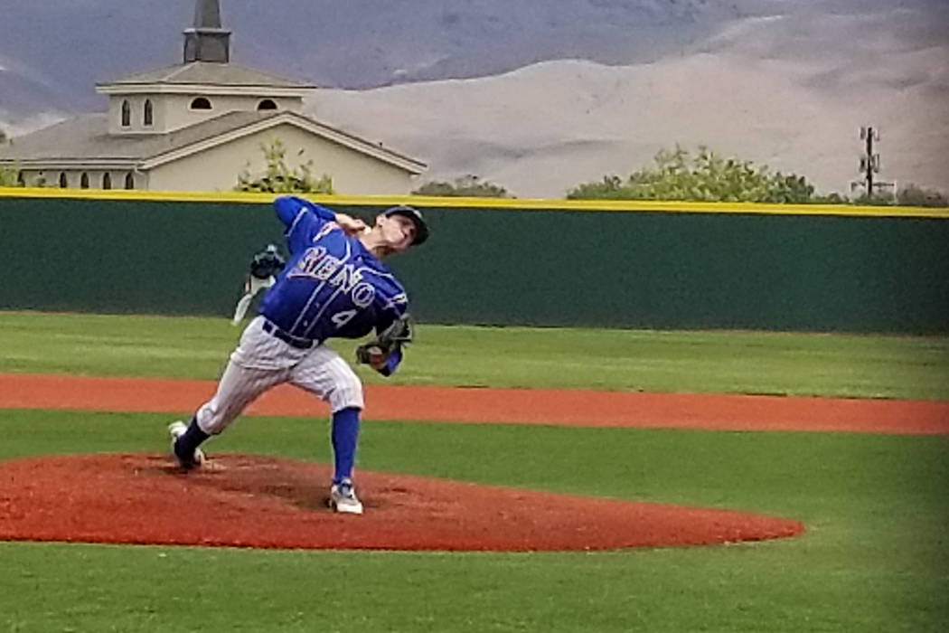 Reno's Brent Thomas delivers a pitch in the Class 4A state baseball tournament on Thursday, May 17, 2018 at Bishop Manogue in Reno. Thomas threw a three-hitter as Reno defeated Basic, 1-0. (Damon ...