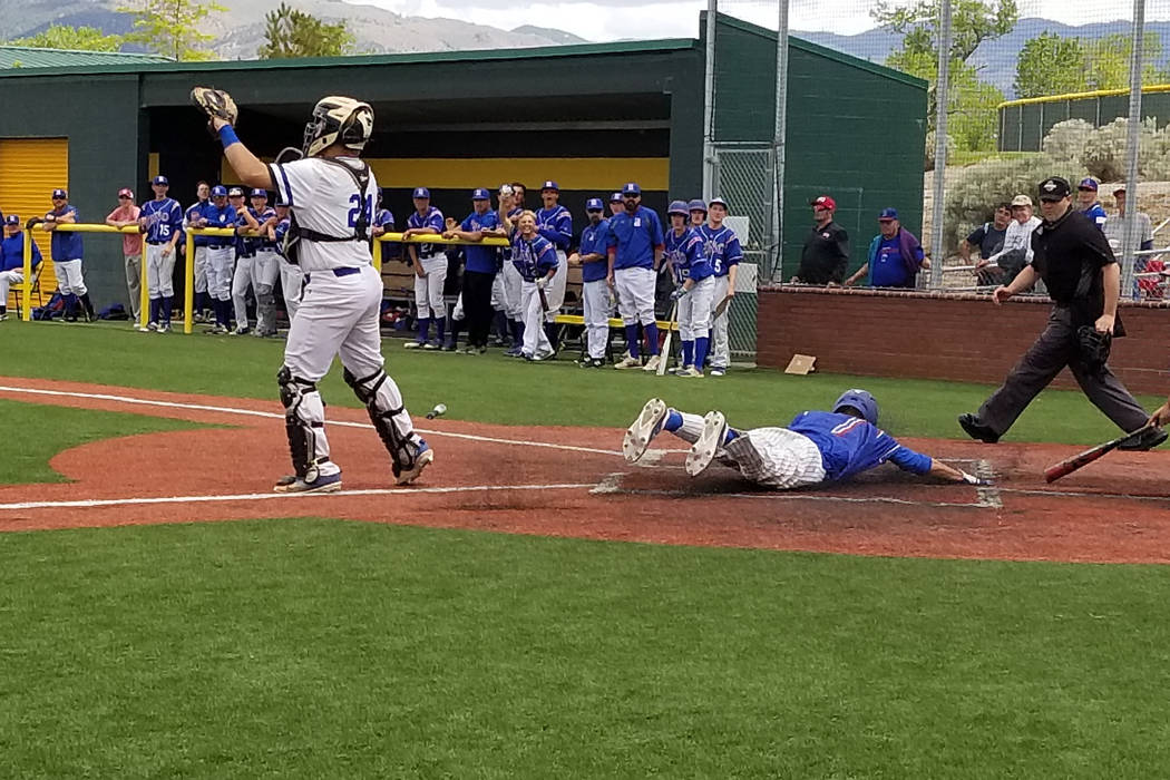 Reno's Sawyer Jaksick dives across home plate with the lone run against Basic in the Class 4A state baseball tournament on Thursday, May 17, 2018 at Bishop Manogue in Reno. (Damon Seiters/Las Vega ...