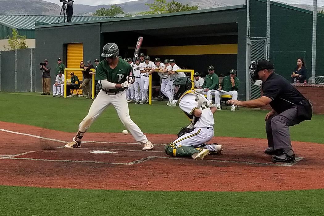 Bishop Manogue catcher Dalton Scolari blocks a pitch as Palo Verde's Jaret Godman bats in the Class 4A state baseball tournament on Thursday, May 17, 2018 at Bishop Manogue in Reno. Palo Verde def ...