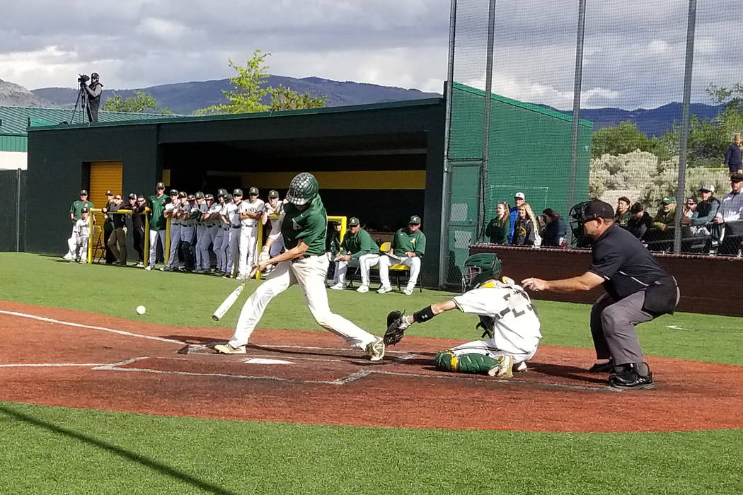 Palo Verde's Peyton Cole hits the ball against Bishop Manogue in the Class 4A state baseball tournament on Thursday, May 17, 2018 at Bishop Manogue in Reno. Palo Verde defeated Manogue, 1-0. (Damo ...