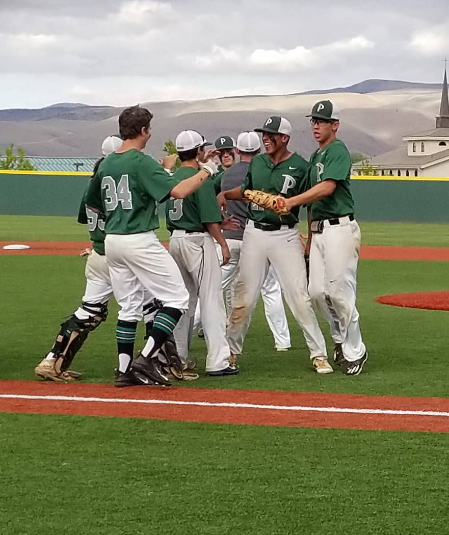 Jaret Godman is congratulated by teammates after recording the final out against Bishop Manogue in the Class 4A state baseball tournament on Thursday, May 17, 2018 at Bishop Manogue in Reno. Palo ...