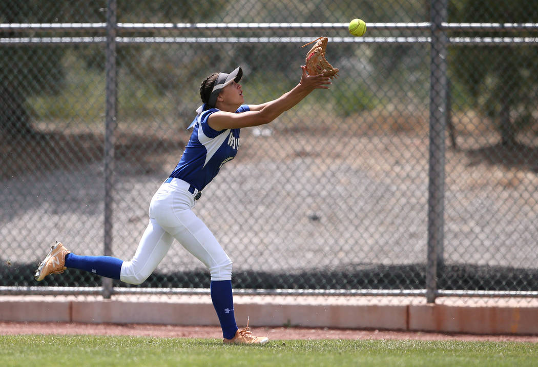 Basic Wolves' Lauren Koshak makes a catch in right field against the Douglas Tigers in the NIAA 4A softball tournament, in Reno, Nev., on Thursday, May 17, 2018. Douglas won 8-5. Cathleen Allison/ ...