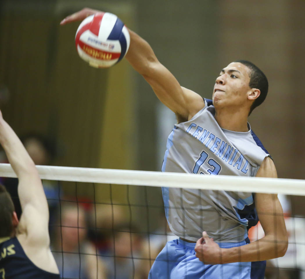 Centennial's Teon Taylor (13) sends the ball to Foothill during the second set of the Class 4A state volleyball championship match at Arbor View High School in Las Vegas on Thursday, May 17, 2018. ...