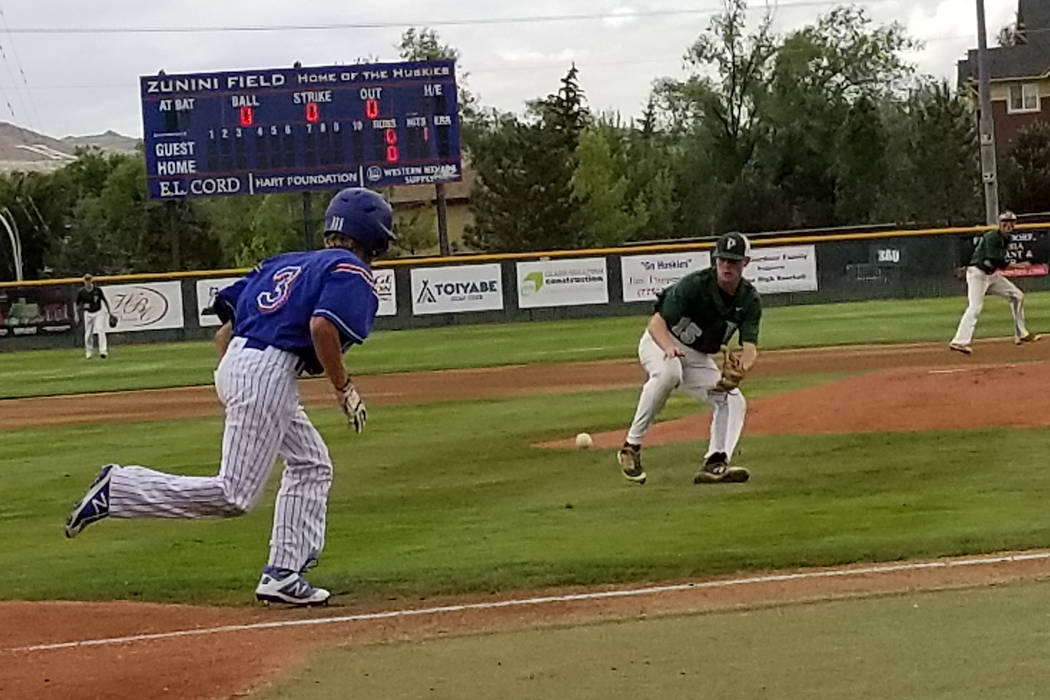 Palo Verde's Bryce Robison fields a bunt as Reno's Garrett Damico runs to first in the Class 4A state baseball tournament on Friday, May 18, 2018 at Reno High. Palo Verde won 5-2. (Damon Seiters/L ...
