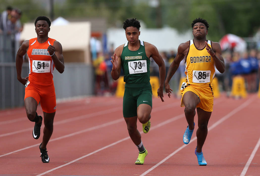 From left, Bishop Gorman's Kyu Kelly, Bishop Manogue's Peyton Dixon and Bonanza's Joey Fox compete in the 4A 100-meter dash the NIAA Track & Field Championships at Carson High in Carson City, Nev. ...