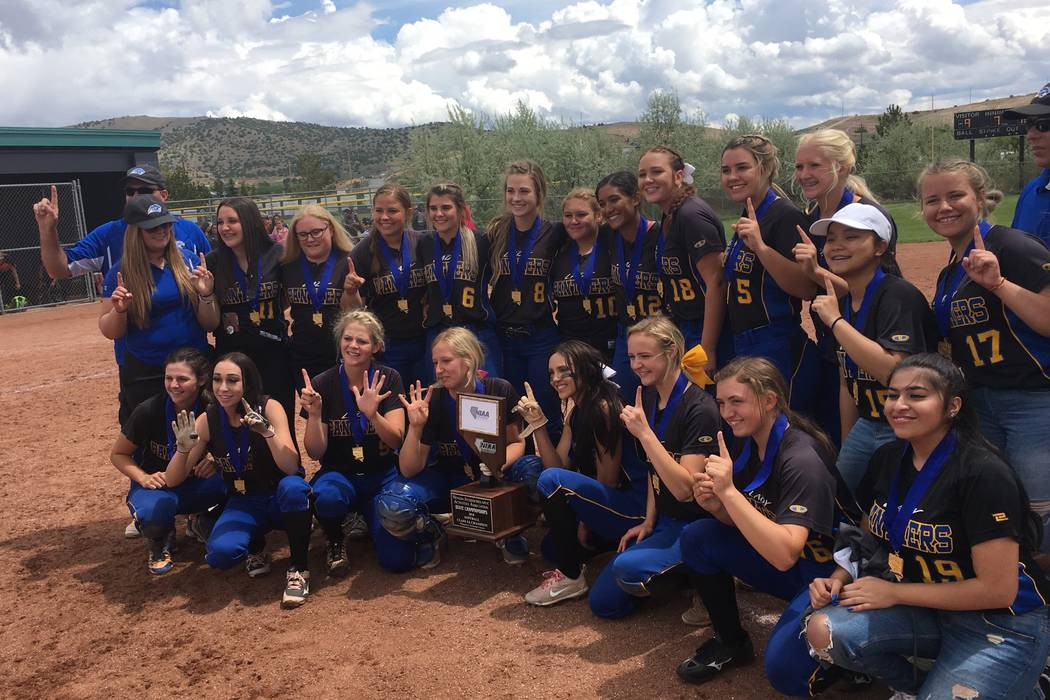 Pahranagat Valley's softball team celebrates winning the Class 1A state softball championship with a 10-9 victory against Wells on May 19, 2018 at North Valleys High School in Reno. Justin Emerson ...