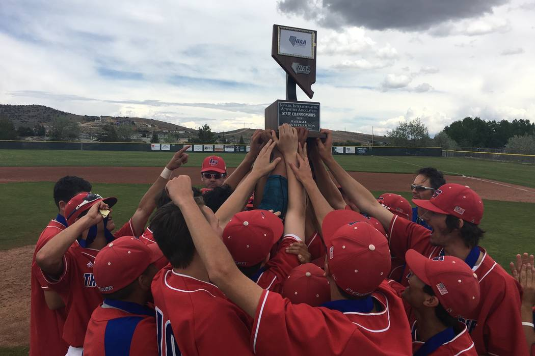 The Indian Springs baseball team celebrates winning the Class 1A state title after a 12-2 victory over Pahranagat Valley on May 19, 2018 at North Valleys High School in Reno. Justin Emerson/Las Ve ...