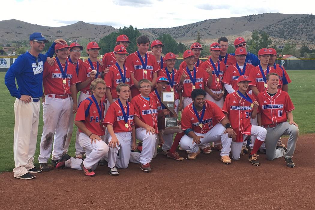 The Indian Springs baseball team poses with the Class 1A state title trophy after a 12-2 victory over Pahranagat Valley on May 19, 2018 at North Valleys High School in Reno. Justin Emerson/Las Veg ...