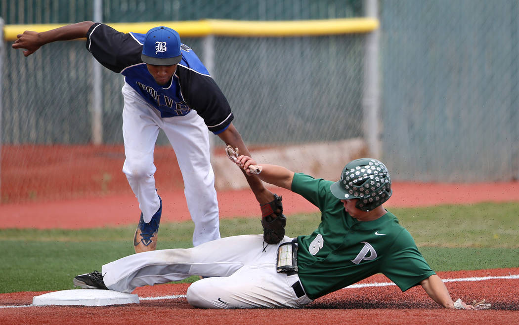Palo Verde's Tyler Kim slides safely under the tag of Basic's Garrett Giles during the NIAA 4A baseball championship game in Reno, Nev., on Saturday, May 19, 2018. Palo Verde won 4-2. Cathleen All ...